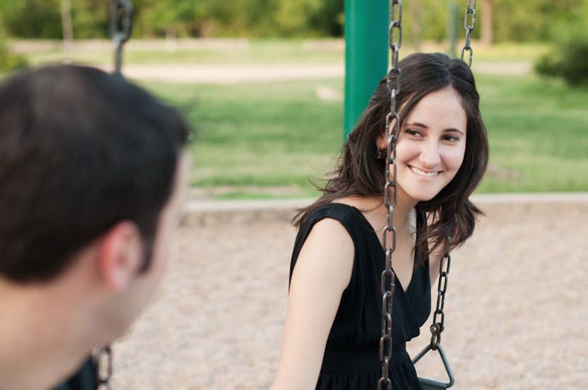 Park swing engagement photos in Austin