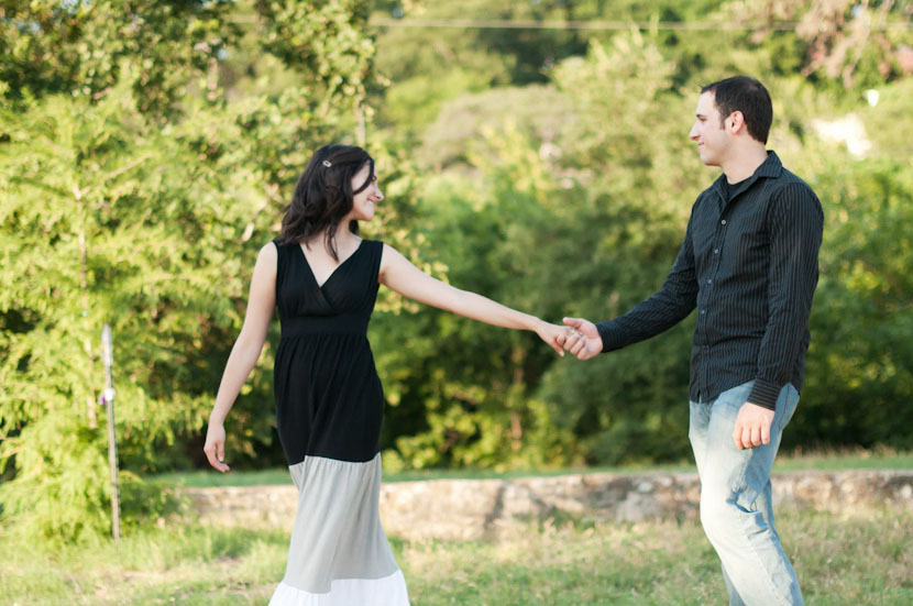 Austin park engagement session: couple holds hands