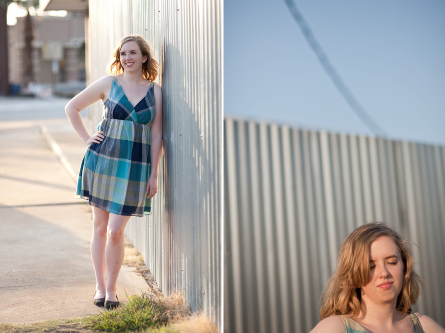 serene college senior photo near corrugated metal wall
