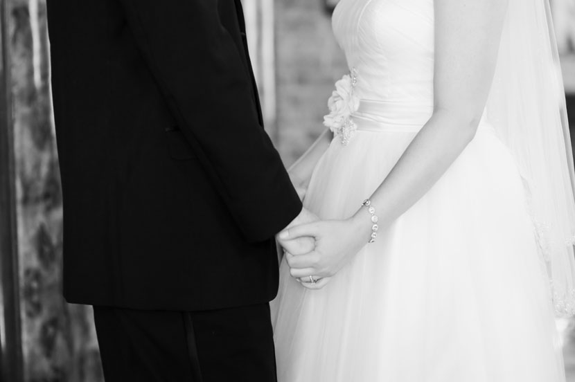 black and white bride and groom holding hands