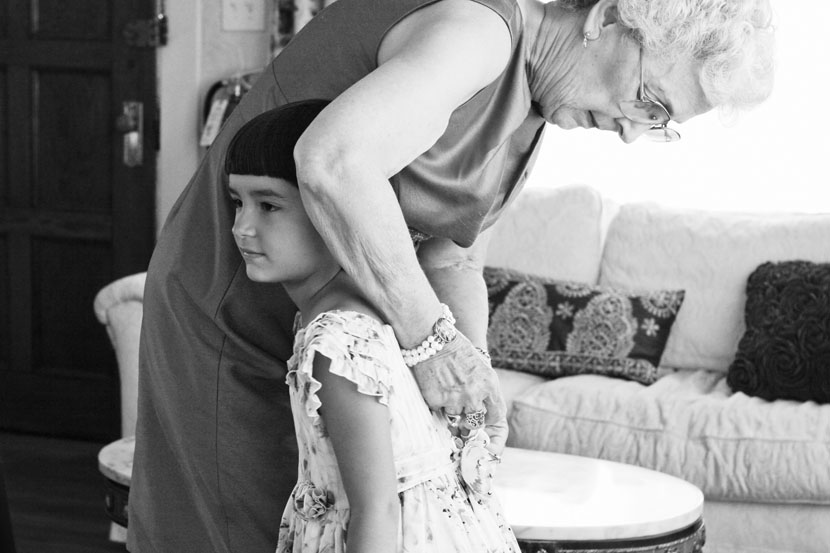 black and white grandmother granddaughter getting ready for wedding