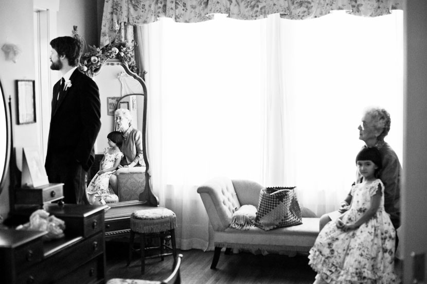 composition in front of window grandmother granddaughter groom austin wedding photography
