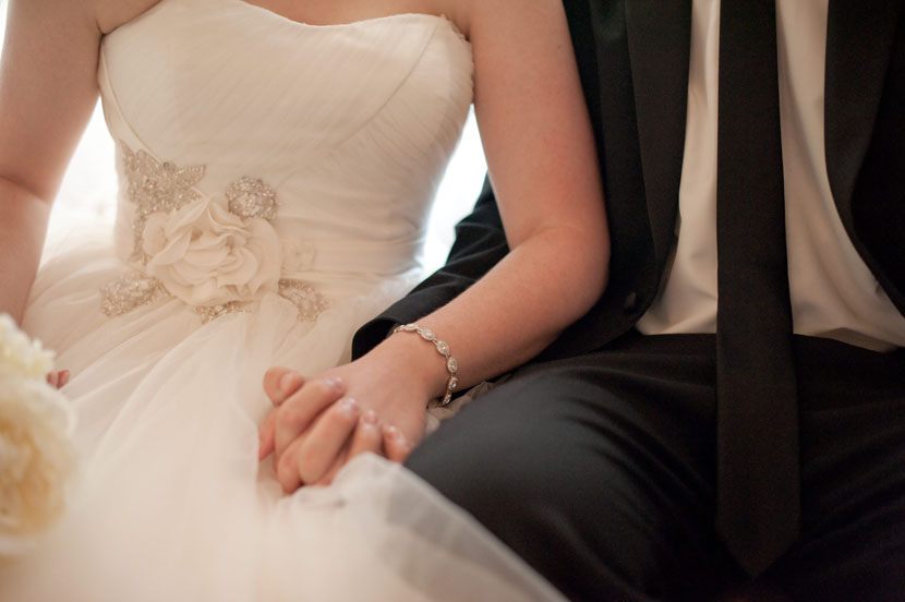 bride groom sitting holding hands