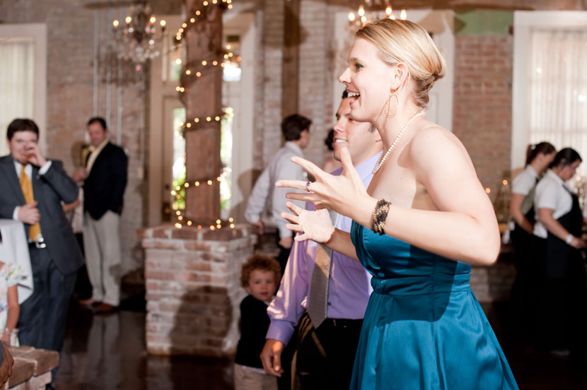 wedding guest getting excited about a song austin photographer