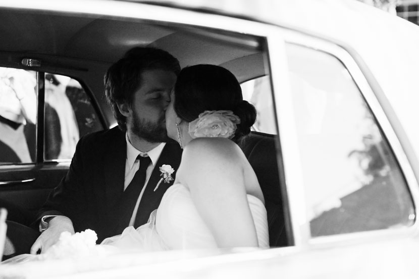 black and white kiss car sendoff wedding