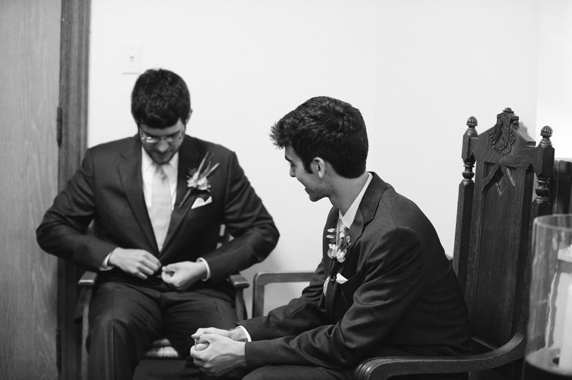 groom nervously adjusts suit waiting for ceremony