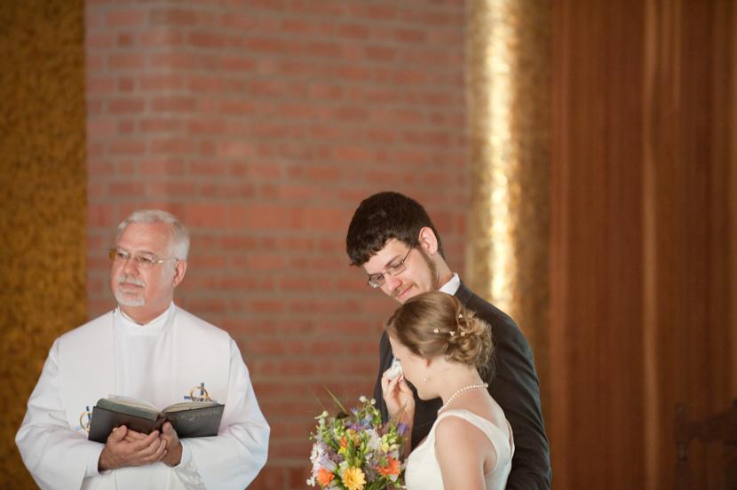 bride wipes away tears with handkerchief