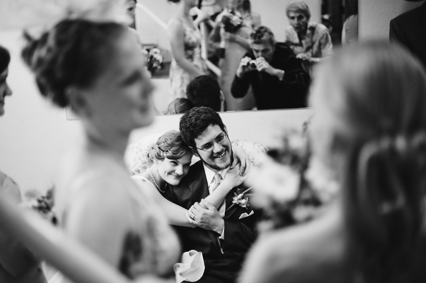 just married couple embrace for photograph black and white