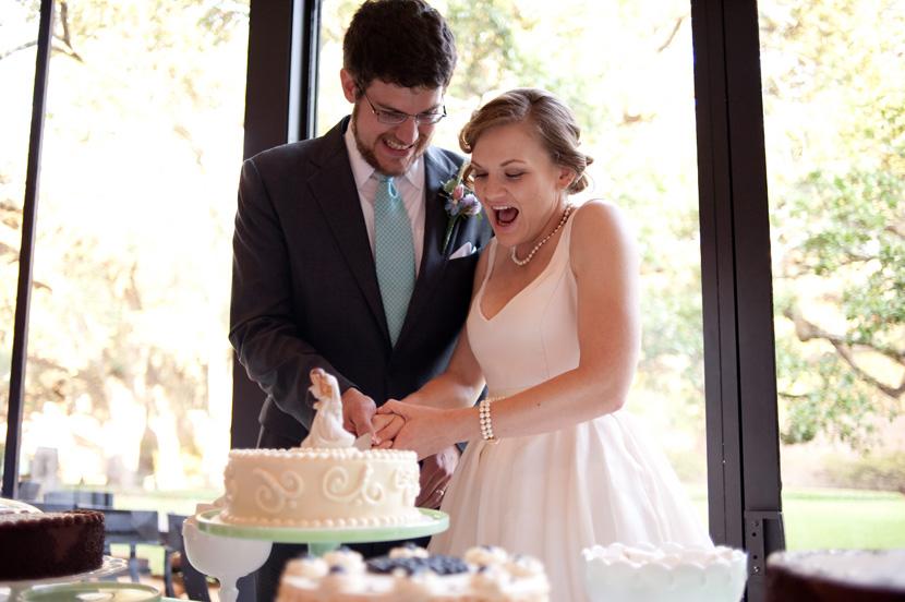 cake cutting enthusiastic bride houston wedding photographer
