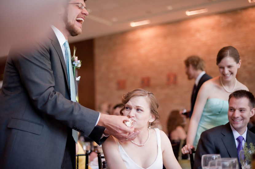 a moment for moment junkie groom feeding bride cake