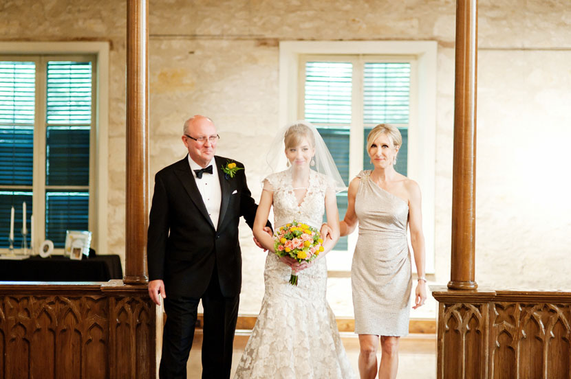 bride led down the aisle by both parents wedding