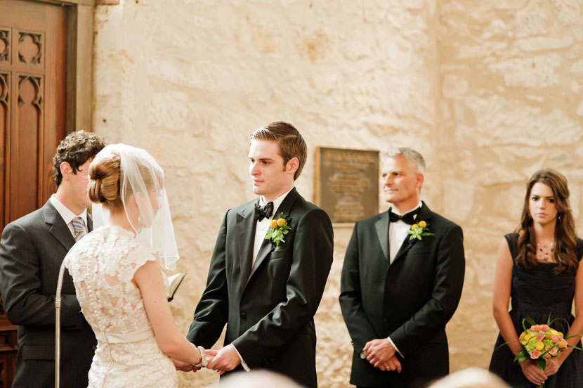groom holding back tears during wedding ceremony