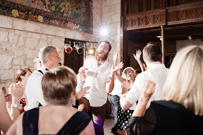 excited guest sings along to dj wedding reception