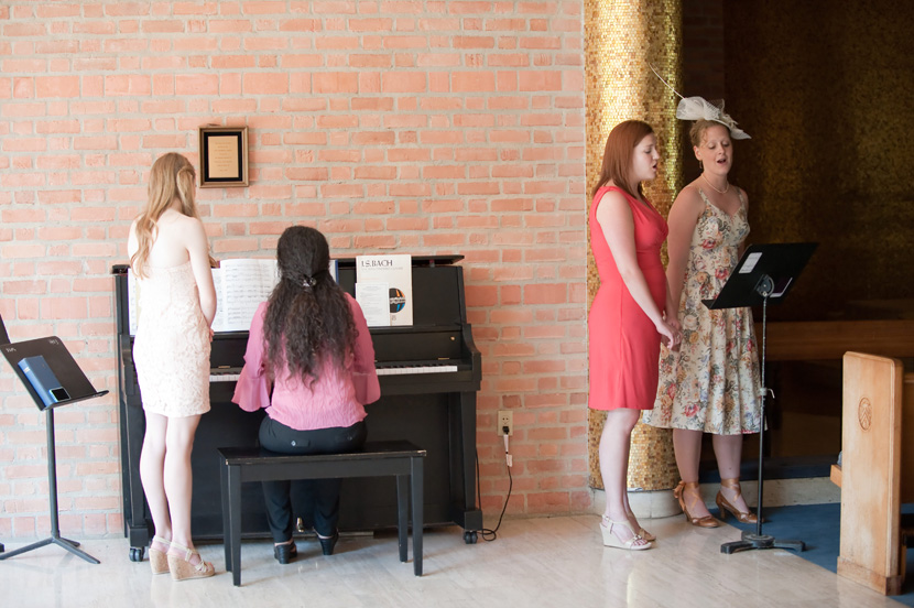 friends singing during wedding ceremony