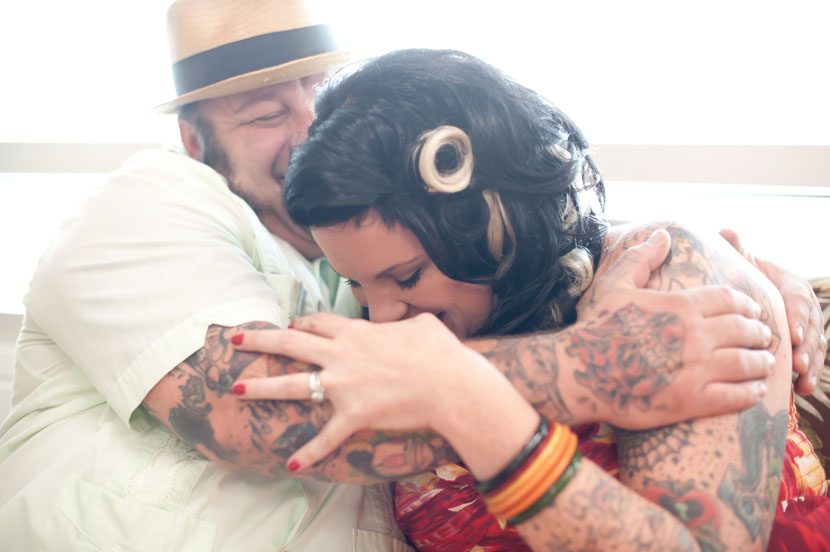tattooed rockabilly couple laughing and hugging austin engagement photographer