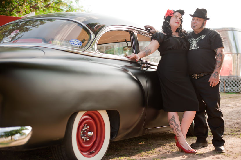 classic car red heels red hubcap badass pose austin engagement photographer