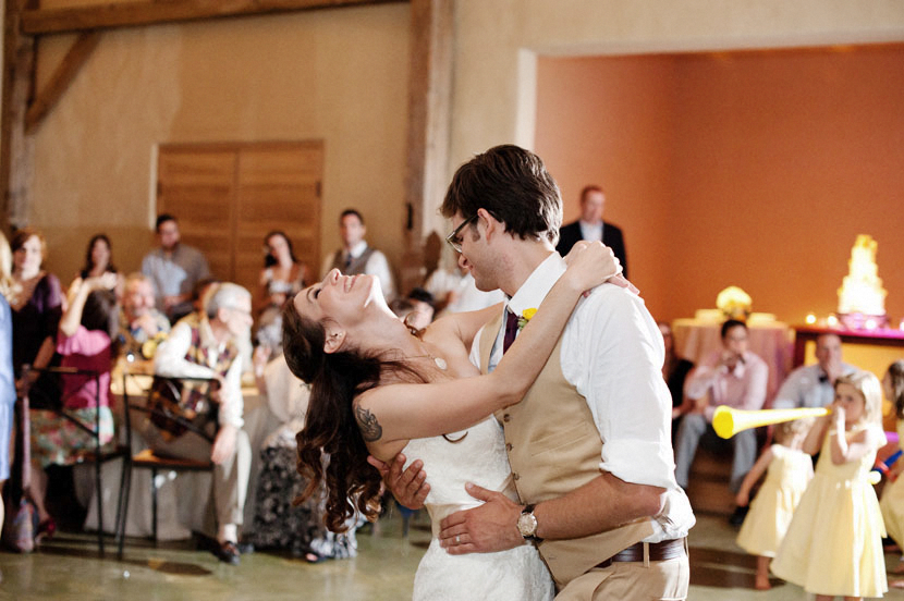 groom dips his bride during wedding reception first dance austin tx