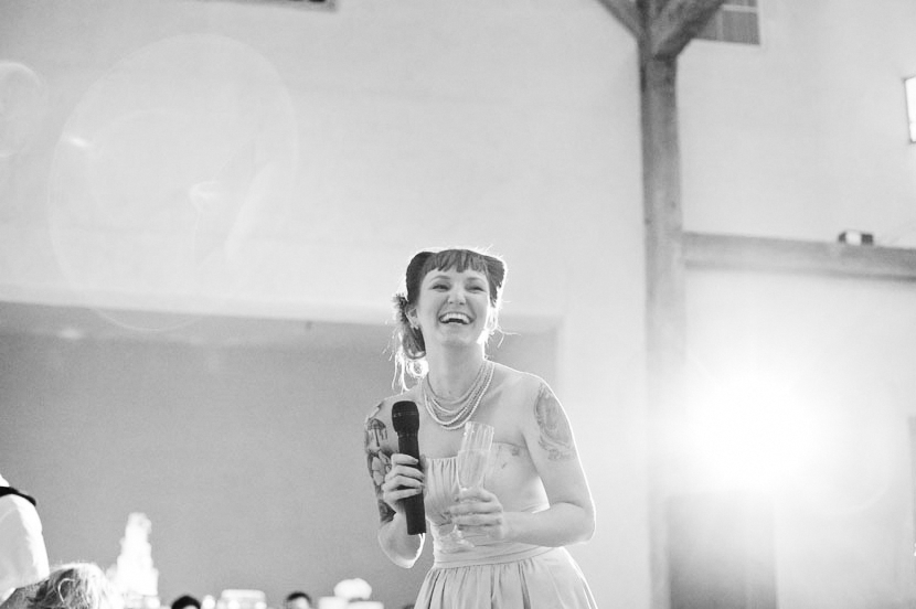 bridesmaid giving a toast black and white
