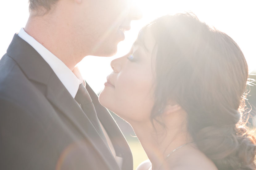 bride groom sunlit kiss austin wedding photos