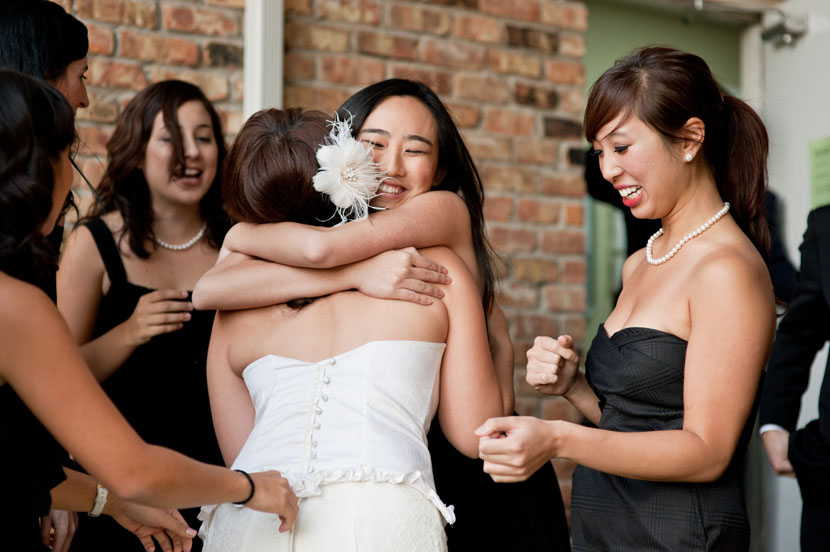 bride hugged by sister austin wedding photographer