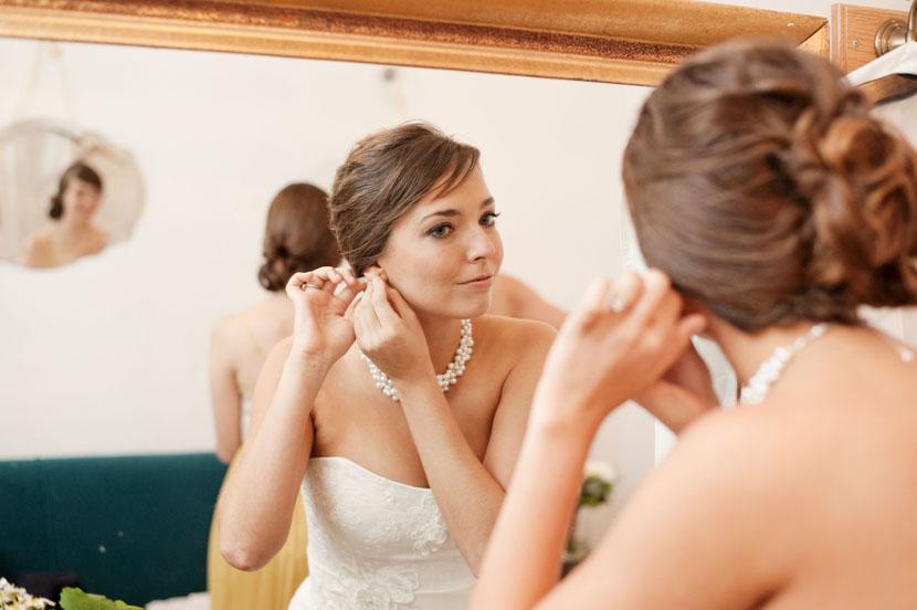 bride putting on earrings at mercury hall