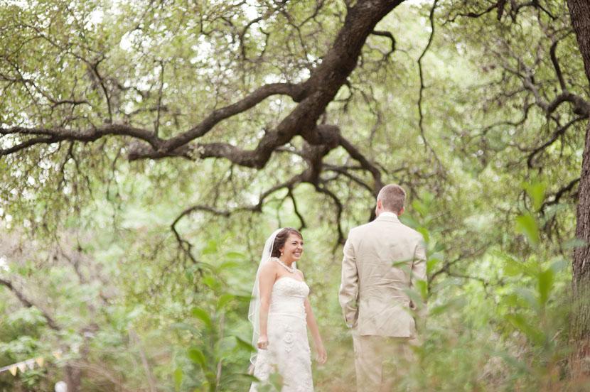 bride and groom first look under mercury hall trees