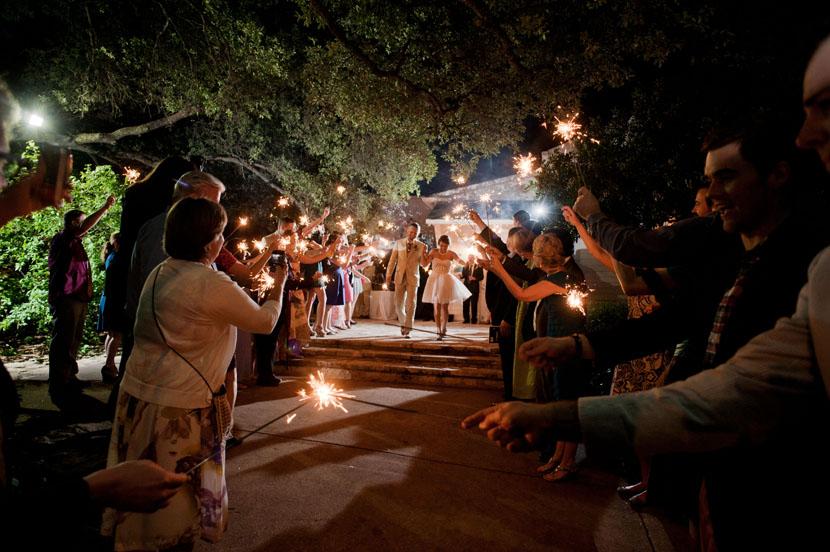 bride groom exit amid sparklers