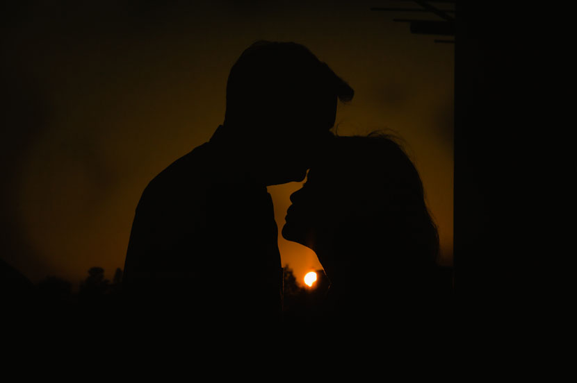 including a solar eclipse in an engagement picture