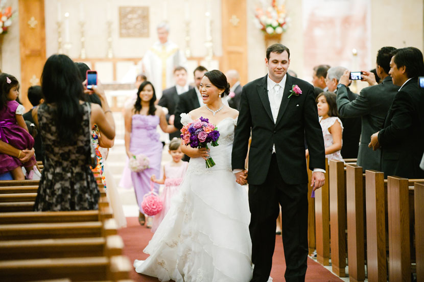 bride and groom walk down the aisle after the ceremony
