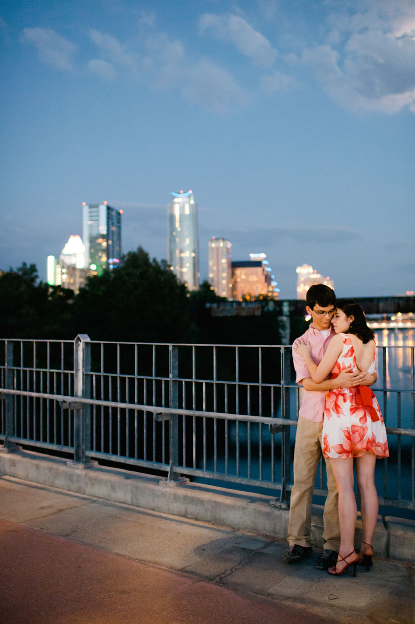 couple poses in front of austin skyline