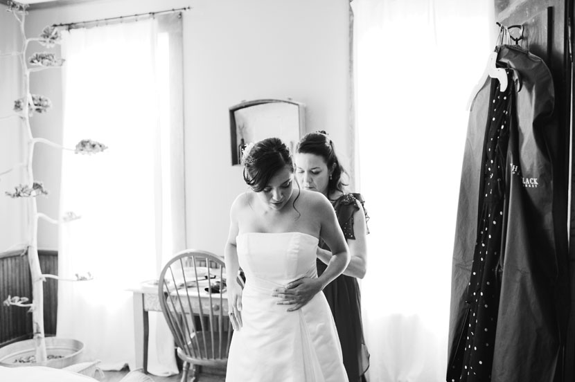 bride getting dressed in natural light