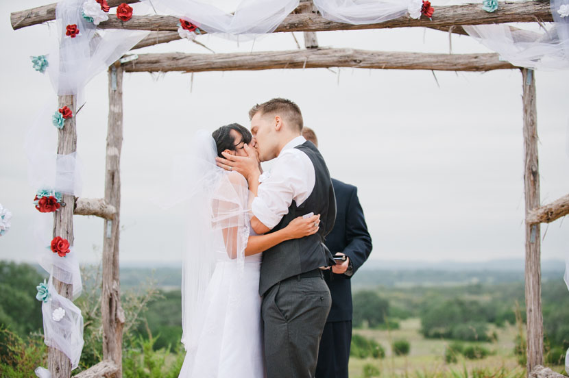 altar kiss between bride and groom
