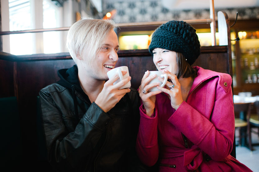 couple laughing in coffee shop
