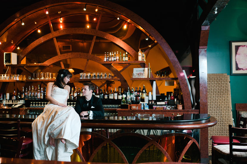 engagement pictures in a bar