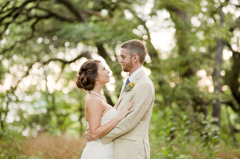 bride and groom face each other in mercury hall wedding photo
