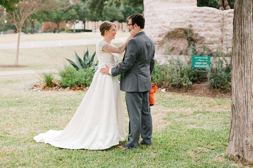 bride and groom first look at austin capitol grounds