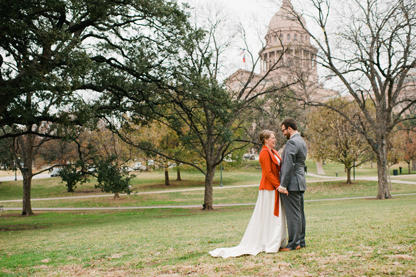 capitol building in background as wedding couple embraces