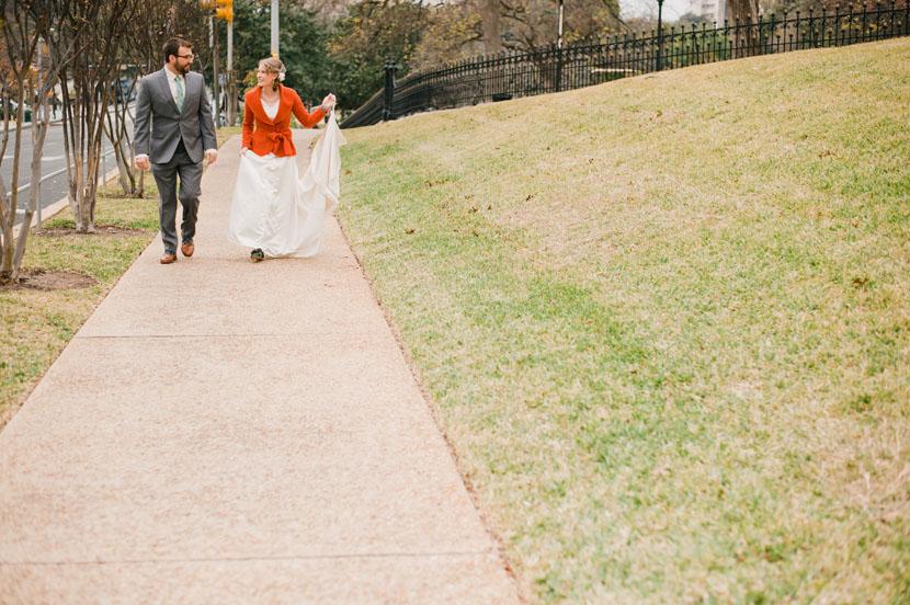 couple walks to the church downtown austin