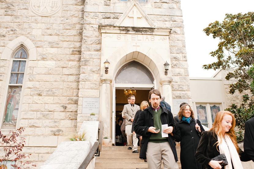 guests leave st elias orthodox church wedding service