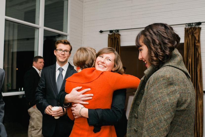 guests hug at wedding