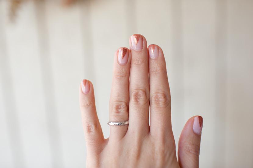 bronze triangles pink background fingernails
