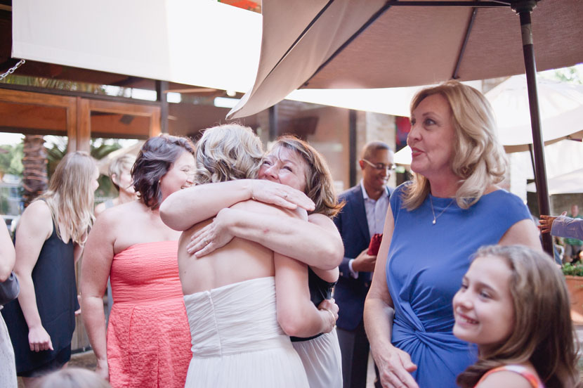 bride is hugged by family after same-sex ceremony in san antonio