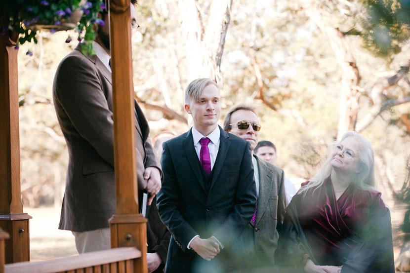 groom waiting at altar sees bride