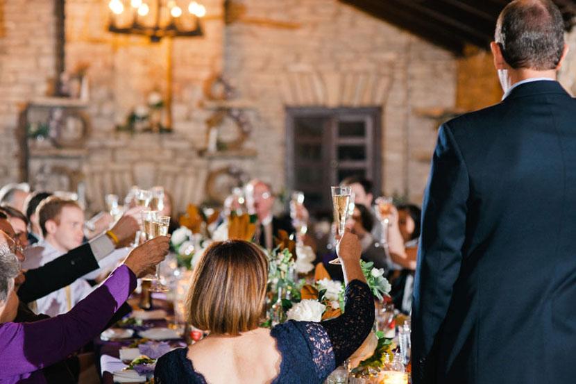glasses raised for toast