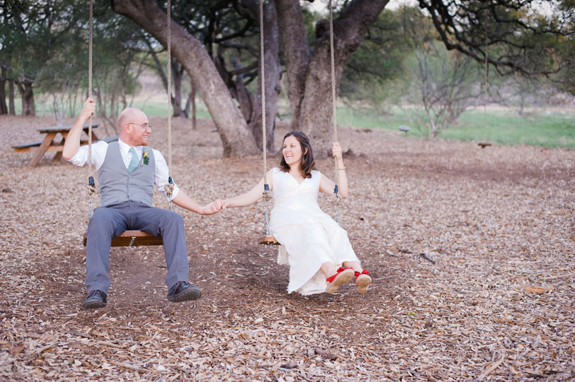 bride and groom on swingsets