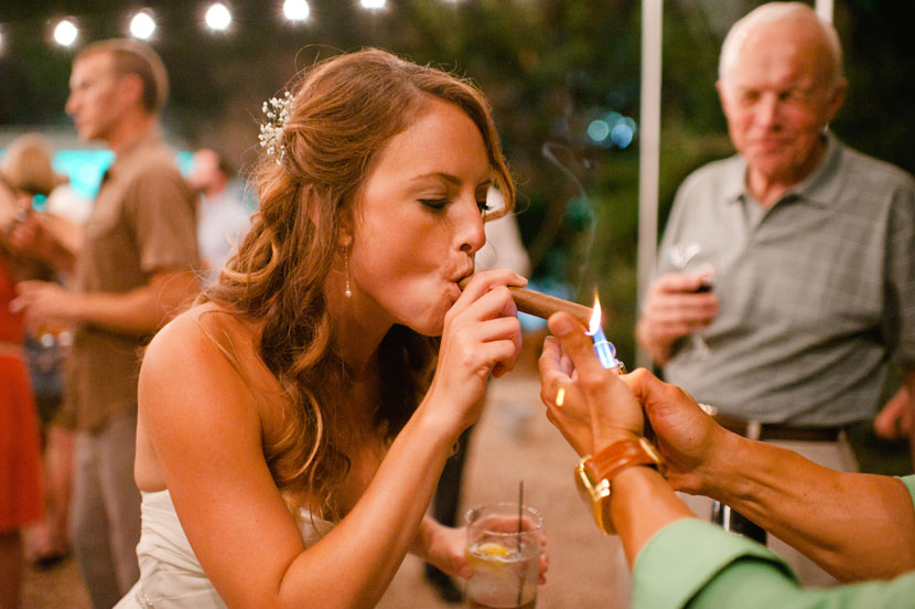 bride smoking a cigar on her wedding day