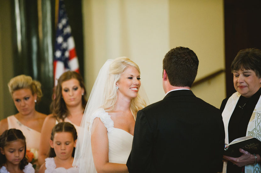bride smiling at the altar