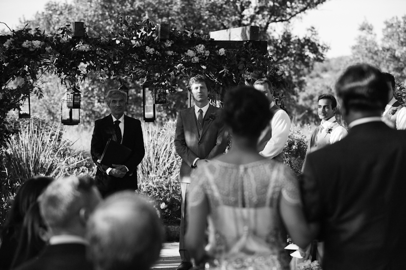 grooms reaction shot as the bride walks down the aisle