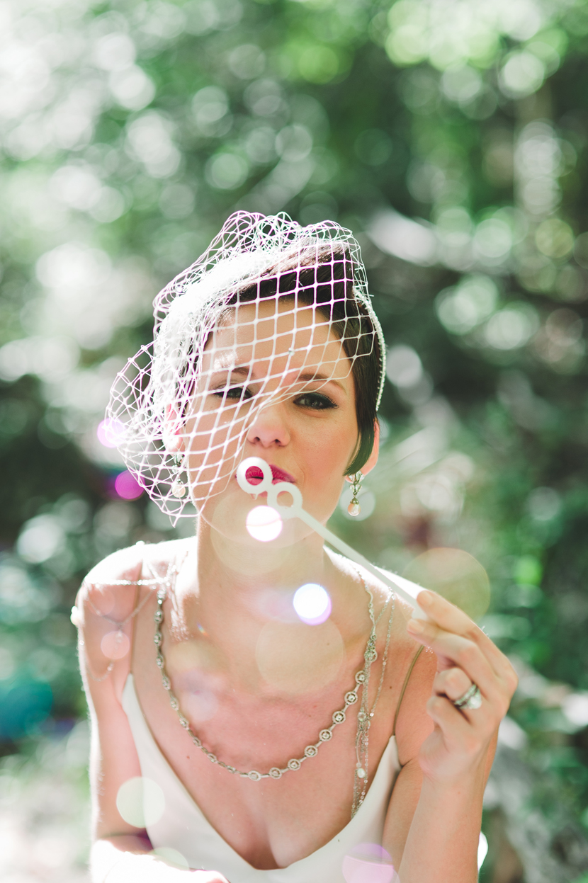 bride blowing bubbles