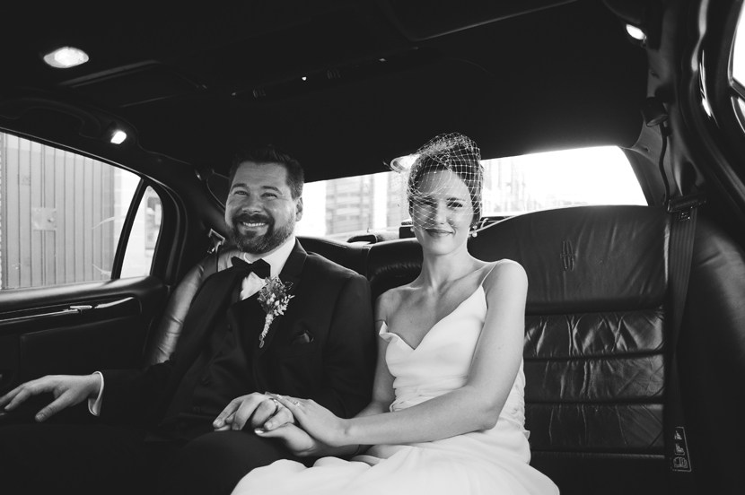 Just married couple in limo // Elissa R Photography